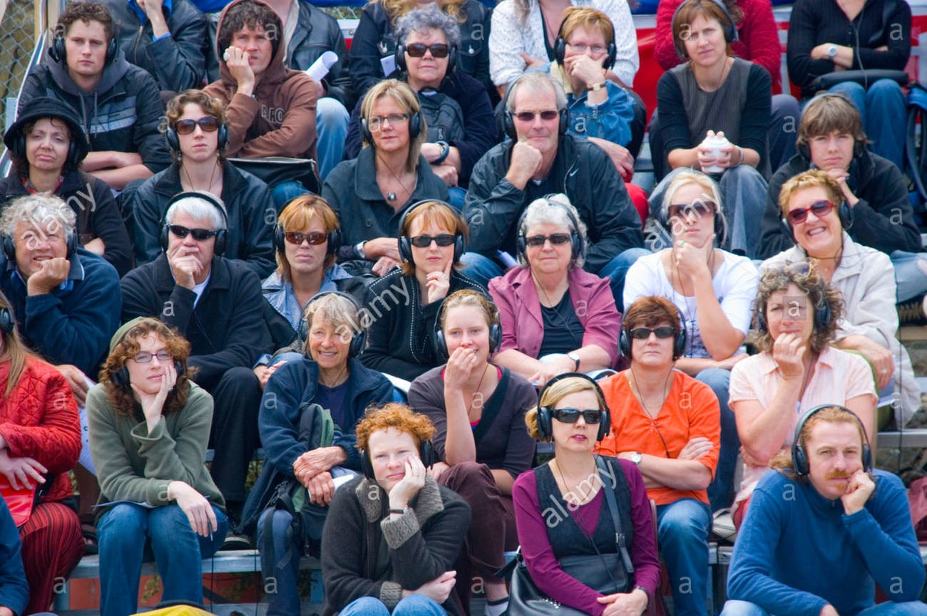 the-audience-at-an-open-air-theatre-experience-listening-intently-A7AB4G.jpg