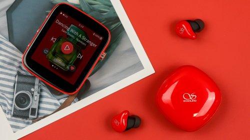Q1 with Bluetooth earphones.jpg