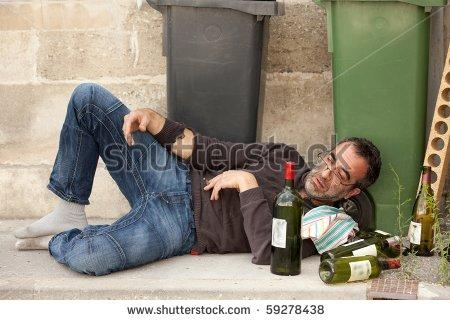 stock-photo-poor-and-drunk-man-lying-on-sidewalk-with-bottles-of-wine-near-trash-can-59278438.jpg
