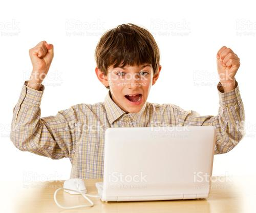 little-boy-exulting-looking-to-the-laptop-picture-id174807597.jpg