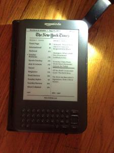 Amazon Kindle 3G with Special Offers and lighted leather cover.