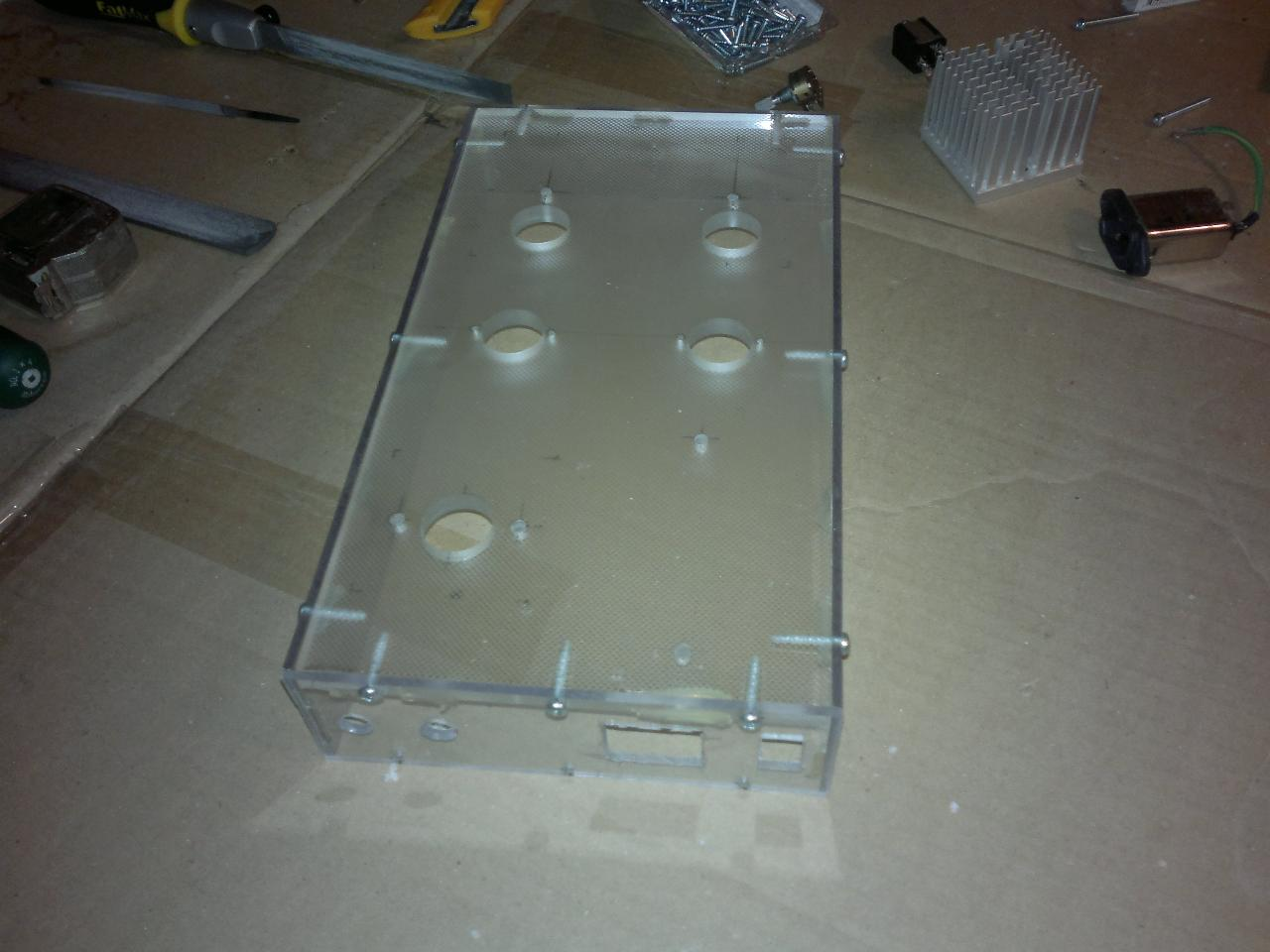 Enclosure built from clear plastic, rear view. The sides are screwed into the top panel. I...