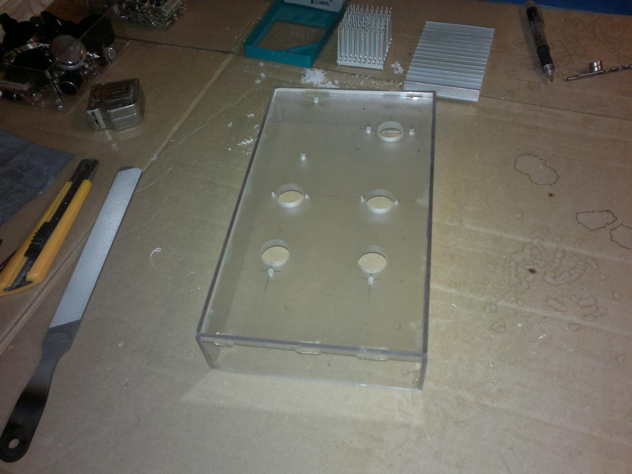 The sides were originally mounted using hot melt glue.