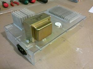 Hardware mounted to the enclosure. The heat sinks and transformers are bolted trough and...