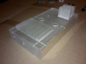 Heat sinks mounted to the enclosure. They are bolted trough and grounded to earth. Front view.