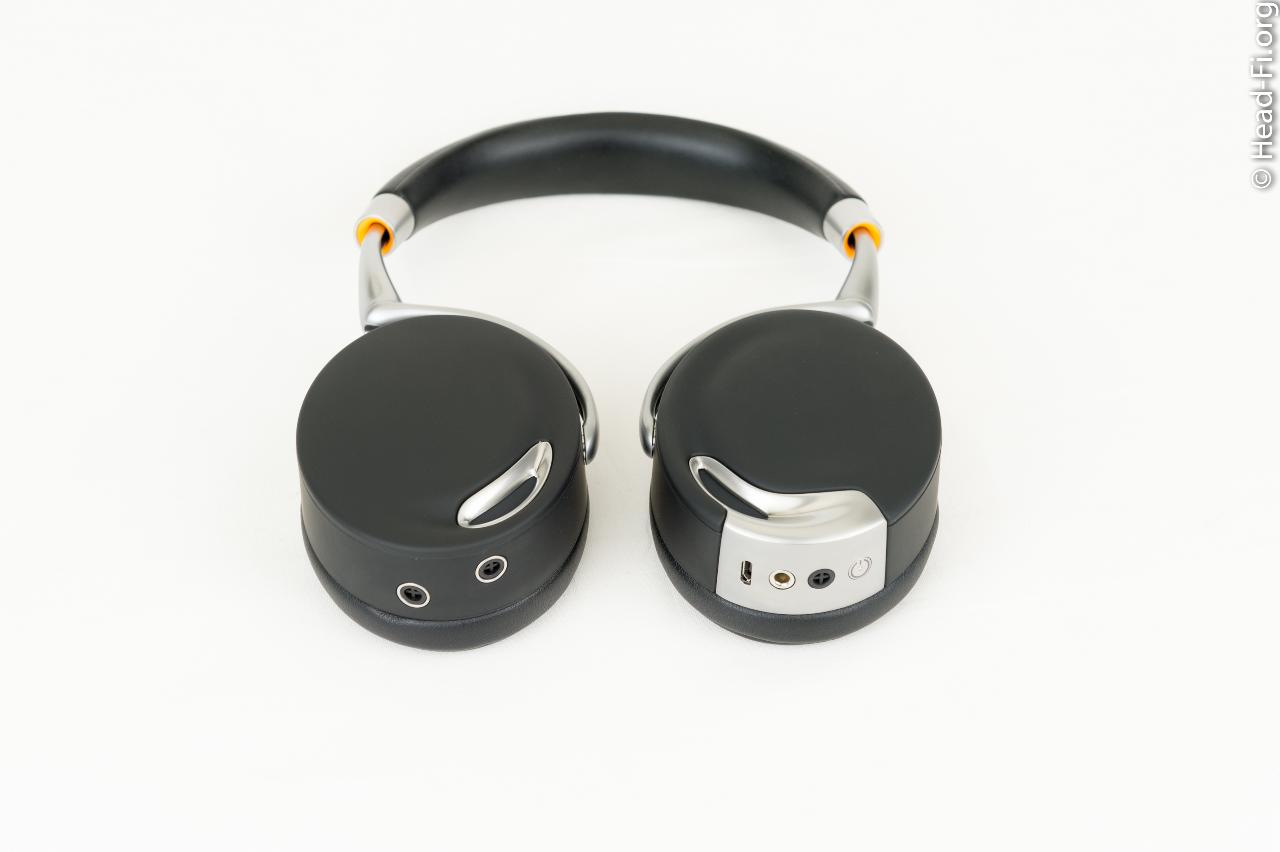 The Parrot Zik (by Philippe Starck) uses four microphones placed internally and externally for...