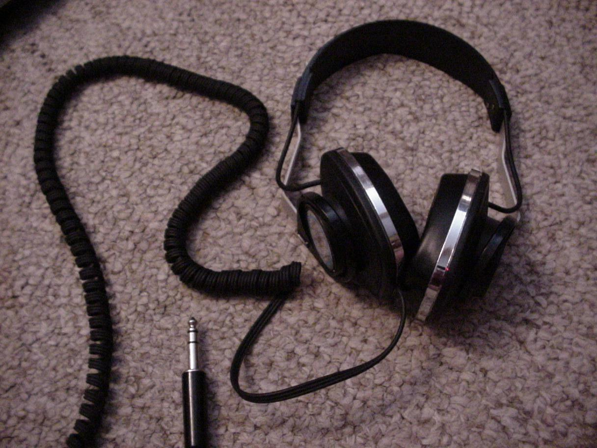 KOSS K/6x Plus. Semi-open back. 8 foot coiled cable. Really light. Over-ear (barely).<br />