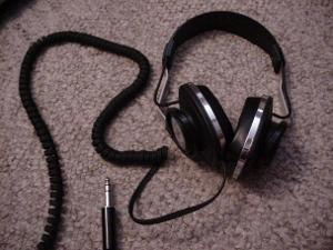 KOSS K/6x Plus. Semi-open back. 8 foot coiled cable. Really light. Over-ear (barely).