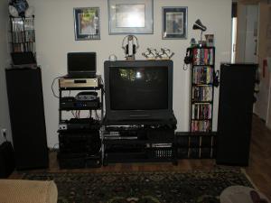 Speaker spread is 6.5 feet. Listening chair about 9ft