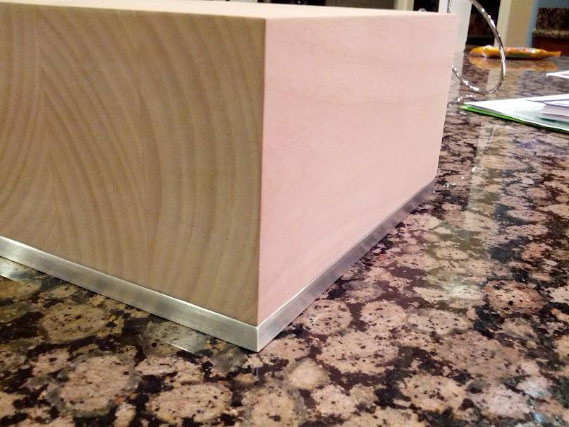 Here is a rough idea of the design.  The wood case will be shorter in the final product.  The...