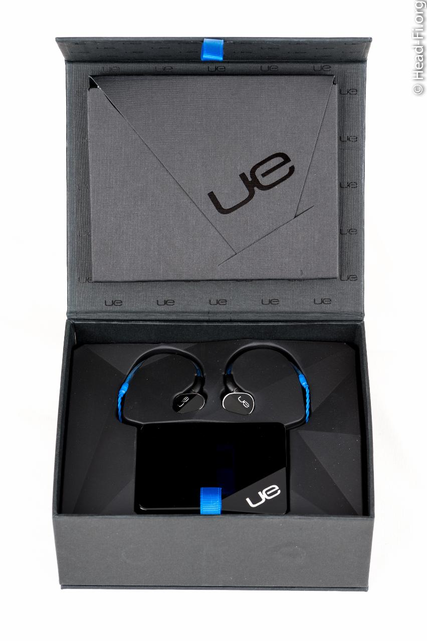 Ultimate Ears UE900 box open, UE900 and its carrying case revealed.