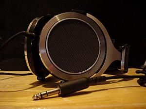 Pioneer SE-700.   Most beautiful headphone ever. Neutral sound without bass or treble extension....