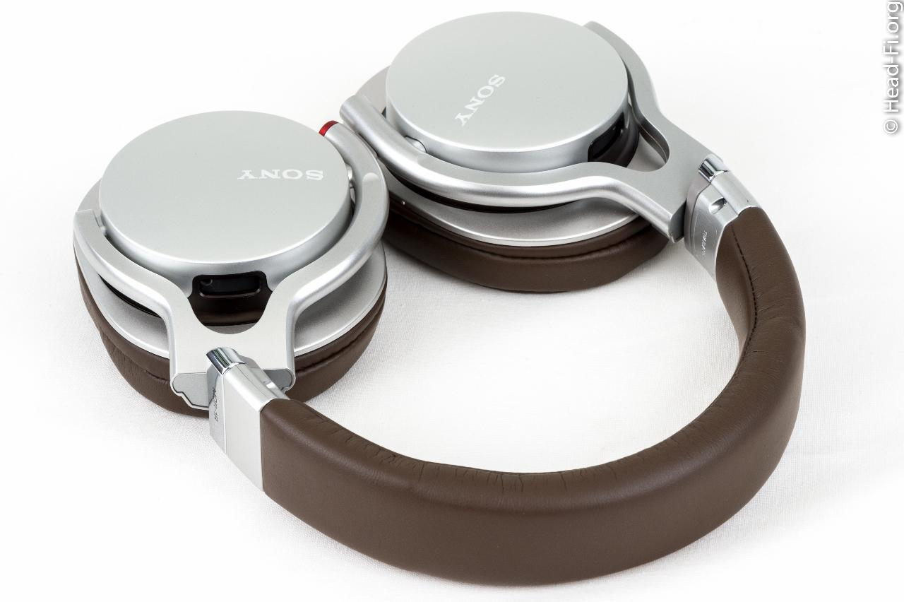 The Sony MDR-1R headphone, with earcups rotated into their flat, stowable positions.