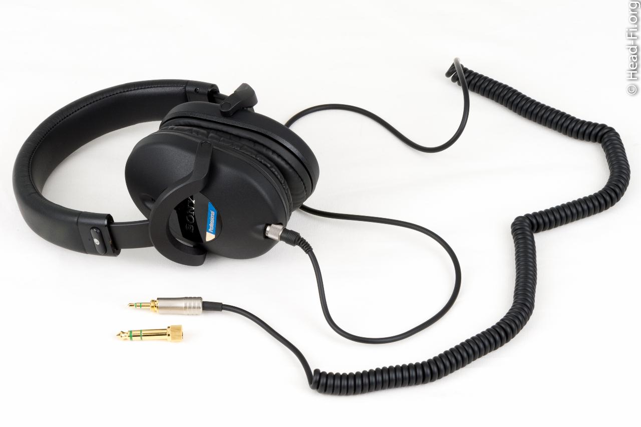 "Sony MDR-7520 with its coiled cable, terminated in 3.5mm, and included 1/4"" adapter."