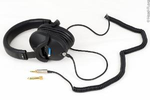 """Sony MDR-7520 with its coiled cable, terminated in 3.5mm, and included 1/4"""" adapter."""