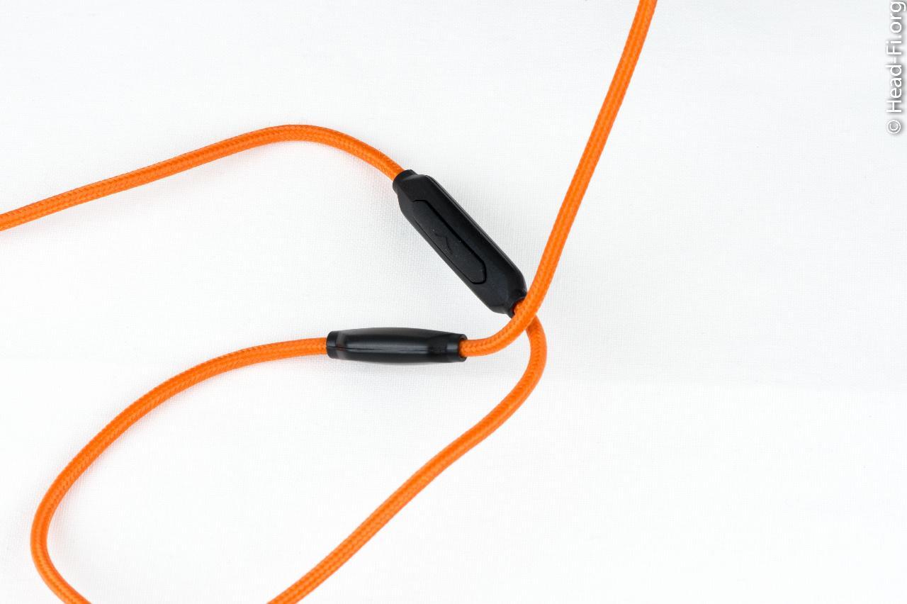 Matte black V-MODA M-100's orange cable.