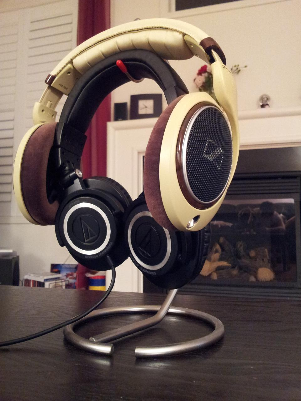My Sennheiser HD 598s overlapping my ATH-M50s on a banana hanger.