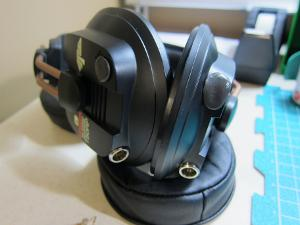 """Sugru plugs to fill stock jack hole and my """"bass port.""""  Will move to epoxy putty at later date..."""