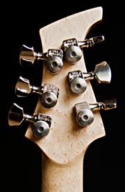 Headstock of my custom made Basta guitar. Birdseye mple with Sperzel locking tuners.