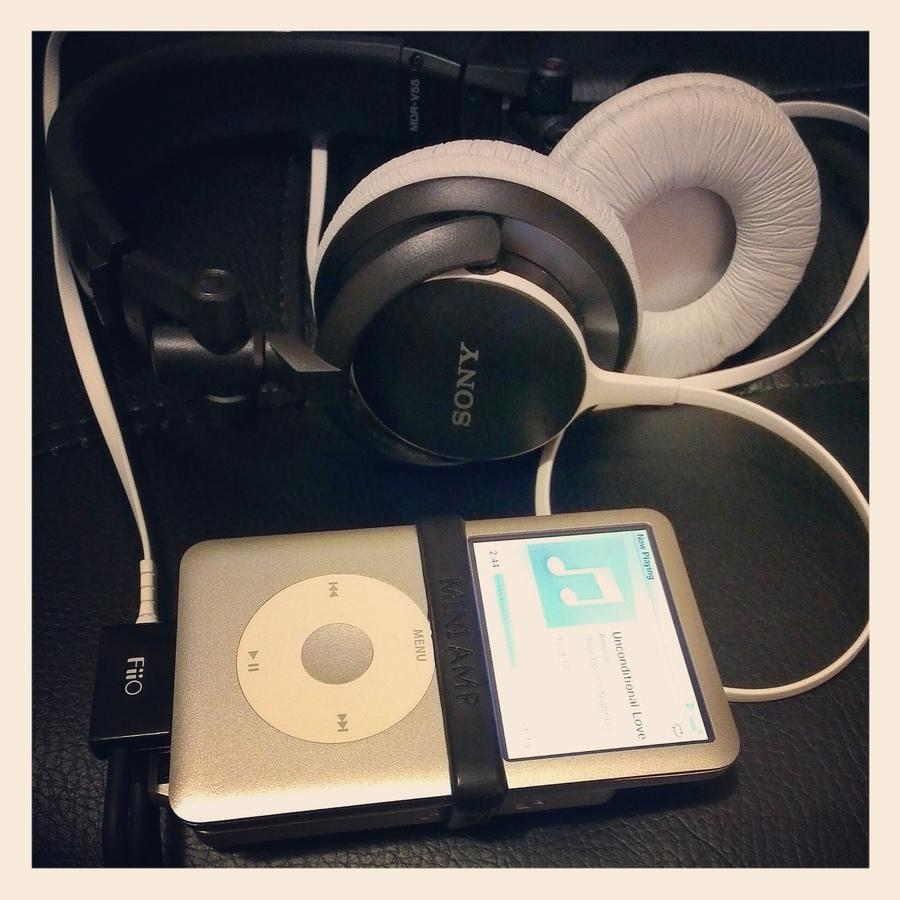 My current rig, iPod Classic 120GB + FiiO E11 amp with L9 dock cable + Sony MDR-V55 phones.