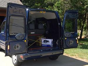 Rear door open, with Alpine 6x9s installed.