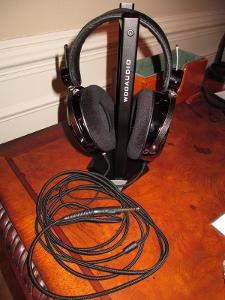 A picture of my HE-4 headphones by HifiMAN resting on the Woo Audio headphone stand.  Also in...