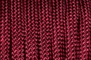 This photo provides a better depiction of the burgundy color of the 550 Lb. paracord.  This...
