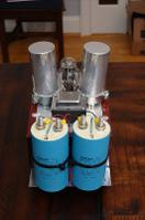 The finished beast. The silver caps on top are 100uf 440V Temco Oil-Filled Motor Run caps. These...
