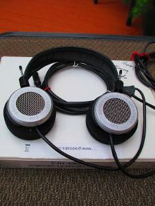 View of headphones and cups from a distance of 2 to 2.5 feet away.  Scratches and scrapes are...