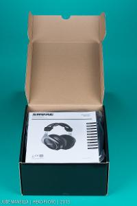 Shure SRH1540 box, opened up, owner manual showing.
