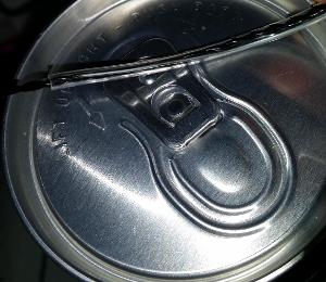rust or something on the memory wire metal wire near the can opener cap
