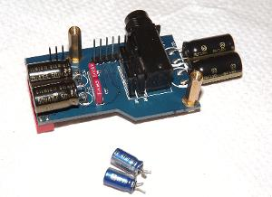 Headphone amplifier board capacitor change to ELNA SilmicII`s. Blue desoldered are Panasonic AM...