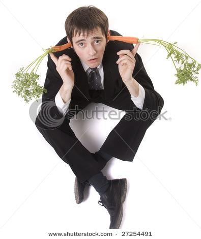 stock-photo-carrots-in-bussinessman-ears-isolated-on-white-27254491.jpg