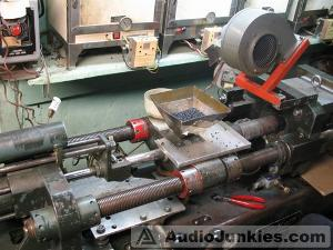 Grado's 45 year old injection molding press that is used to make all of their plastic parts in-house