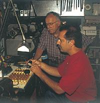 John Grado and Chaipis inspecting cartridges