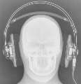 High-tech image of a headache in the making. It's a skull wearing the Q701! This is one of two images, this one set to optimally image the Q701. I set the kilo-voltage peak down to 50 to ensure...