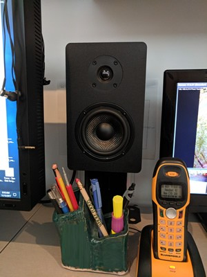 For speaker stands, using Simpson Strong Ties meant for attaching fence posts to concrete....
